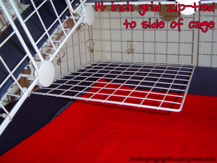 14 inch grid zip-tied to the side of the cage